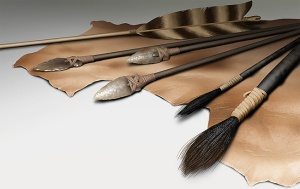 Illustration of flint-tipped arrows, primitive paint brushes on top of rough hide.